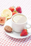 Tea,cookie, fig and strawberries on a plate Royalty Free Stock Images