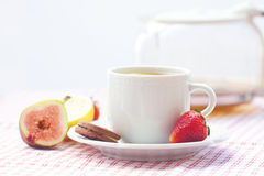 Tea,cookie, fig and strawberries on a plate Royalty Free Stock Image