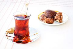 Tea and cookies. Turkish tea with some cookies on the table stock photos