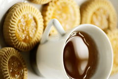 Tea and cookies. A picture of a cup of tea and some delicious cookies on a white plate Royalty Free Stock Photo