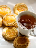 Tea and cookies. A picture of a cup of tea and some delicious cookies on a white plate Royalty Free Stock Photos