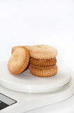 Tea cookies arranged on a digital scale to measure Royalty Free Stock Photo