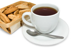 Tea with cookies in basket Stock Images