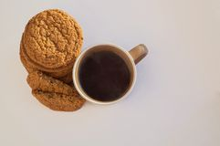 Tea with cookies. Coffee and cookies closeup on the white background topview royalty free stock images