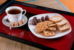 Tea cookies, crackers and candies on a tray Stock Images