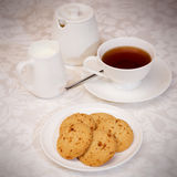 Tea and cookies. A cup of tea with cookies,milk jug and sugar bowl Royalty Free Stock Photo