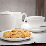 Tea and cookies. A cup of tea with cookies,milk jug and sugar bowl Royalty Free Stock Photos