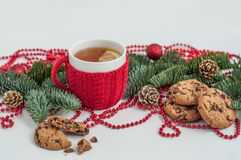 Tea and cookies with festive decoration. Composition on background of Christmas decorations. New Year Stock Photos