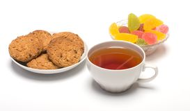 Tea, cookies and fruit candy. Stock Photo