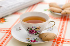 Tea, cookies and the newspaper Royalty Free Stock Images