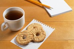 Tea, cookies and notepad Royalty Free Stock Images