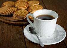 Tea and cookies on a  table Royalty Free Stock Images