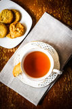 Tea with cookies on wooden background royalty free stock photography