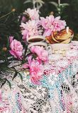 Tea in country style in summer garden. Two cups of black tea and pancakes on handmade crocheted vintage lacy tablecloth and royalty free stock photos
