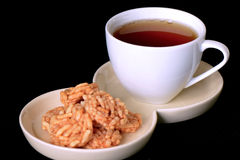 Tea and crispy rice snacks. Royalty Free Stock Images