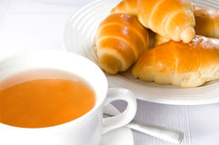 Tea with croissant Stock Photos