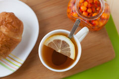 Tea with croissant and jam. Tea with croissant and sea buckthorn jam Stock Photo