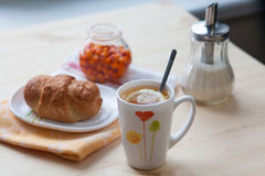 Tea with croissant and jam. Tea with croissant and sea buckthorn jam Royalty Free Stock Image