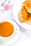 Tea and croissants stock images