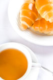 Tea and croissants Stock Photos