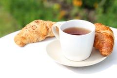 Tea and croissants Stock Photos