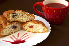 Tea and croissants. A cup of fruit tea with fresh golden croissants Royalty Free Stock Photos