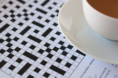 Tea and crossword. Uncompleted crossword grid with a cup of tea Stock Photo