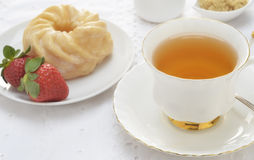Tea  with cruller and strawberries Royalty Free Stock Photos