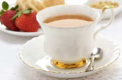 Tea  with cruller and strawberries Royalty Free Stock Photography