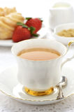 Tea  with cruller and strawberries Stock Photos