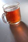Tea cup. Glassy tea cup with light from behind Stock Photos