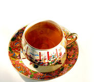 Tea cup. Tea in a china porcelain cup on white stock images