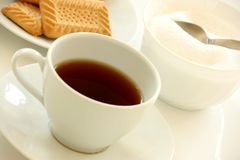 Tea Cup. White tea cup with biscuits and sugar bowl royalty free stock photo