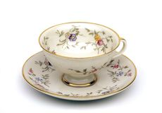 Tea cup. Antique tea cup with little flowers Stock Images
