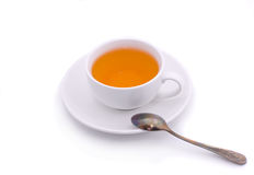 Tea cup. Bright tea in a white cup on a white background Royalty Free Stock Photos