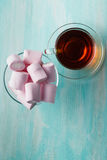 Tea Cup And Pink Marshmallows Stock Photography