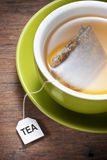 Tea Cup Bag Tag. A cup of tea with a steeping tea bag Royalty Free Stock Photo