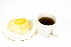 Tea cup with bakery Stock Images