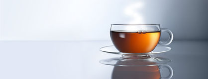 Tea Cup Banner Background. A cup of tea in a banner format with horizon line. and reflection Royalty Free Stock Images