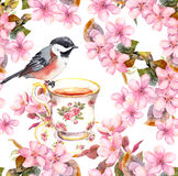 Tea cup, bird and blooming flowers. Seamless floral pattern. Watercolour art on white background Stock Images