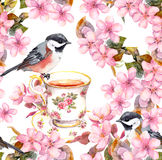 Tea cup, birds and flowers. Seamless floral pattern. Aquarelle drawing on white background Stock Images