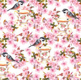 Tea cup, birds and flowers. Seamless floral pattern. Watercolor design on paper background Stock Image