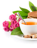 Tea in cup with biscuits and bouquet roses Stock Photo