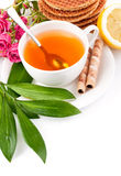Tea in cup with biscuits and lemon Stock Photos