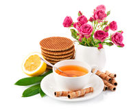 Tea in cup with biscuits and lemon Royalty Free Stock Photo