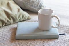 A tea cup on book over bed stock photos