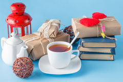 Tea cup with books and gift Royalty Free Stock Images