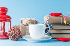 Tea cup with books and gift Royalty Free Stock Image