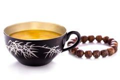 Tea cup & Bracelet. Tranquil, Meditation Stock Image