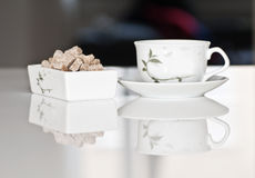 Tea cup with brown sugar Royalty Free Stock Photography